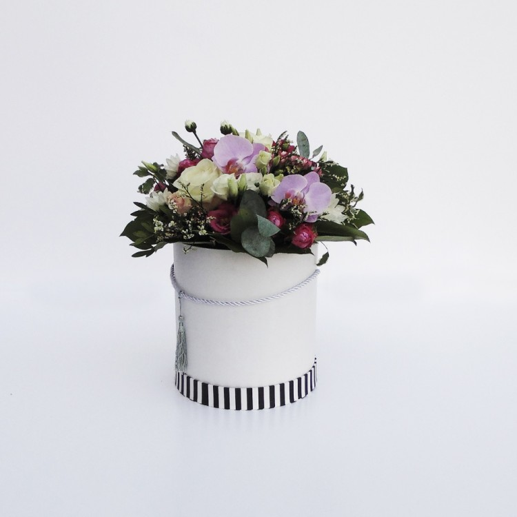 A box of flowers with a rose, chrysanthemum and phalaenopsis